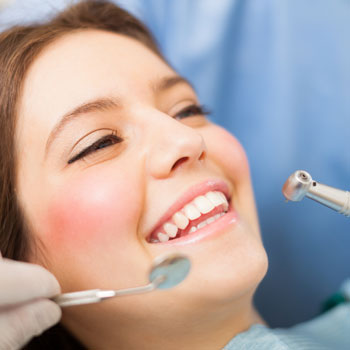 Smiling woman at dental clinic
