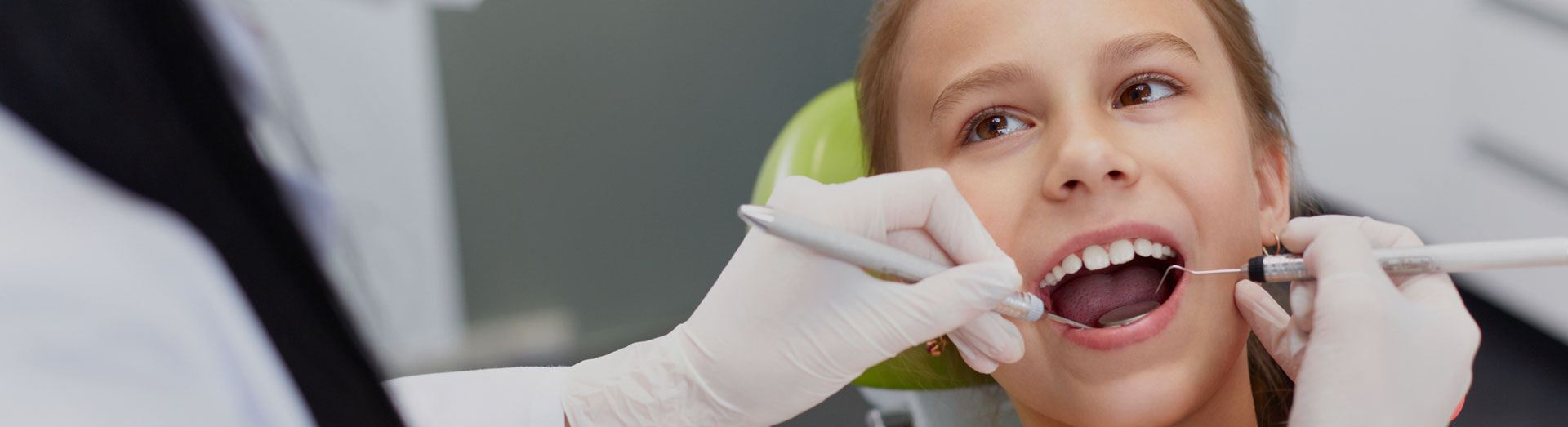 Dentist checking teeth of a child